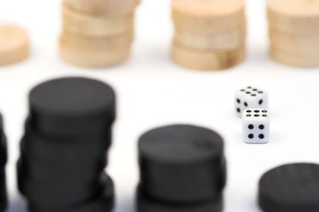 Backgammon chips and dices isolated on white background  photo