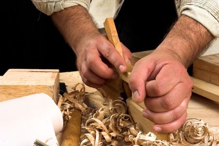 carpenter's hands - working with plane Stock Photo - 5518623