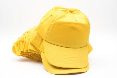 Yellow baseball caps over white Stock Photo - 5726837