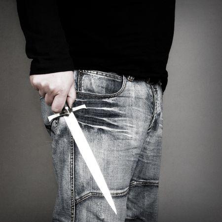 maniac: man holding a dagger