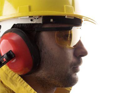 lavoratore con casco giallo over white   Archivio Fotografico