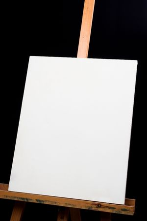 canvas on easel over black background Stock Photo - 6618755