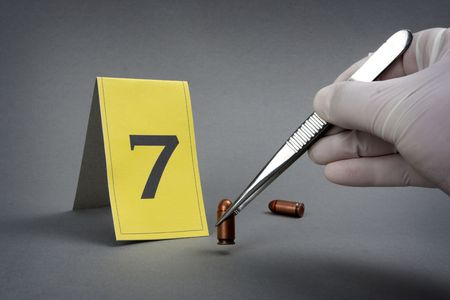 bullet proof: collect evidence-an investigator collect fired cartridge