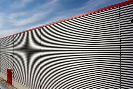 sky and corrugated facade of warehouse Stock Photo