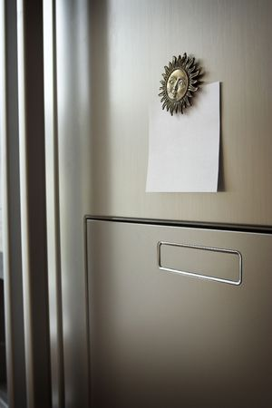Blank paper on refrigerator door.  photo
