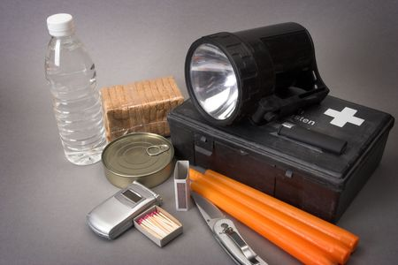 safety first: Items for emergency over gray Stock Photo