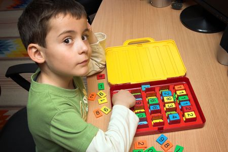 Boy playing with numbers