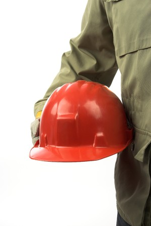 personal safety: man holding red helmet over white  Stock Photo