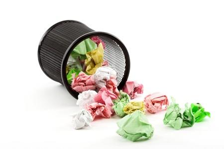 rubbish bin: Spilled trash bin full of crumpled paper