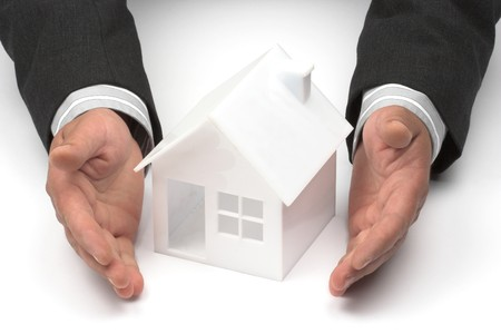 Hands and  house model. Real property or insurance concept Stock Photo - 7058799