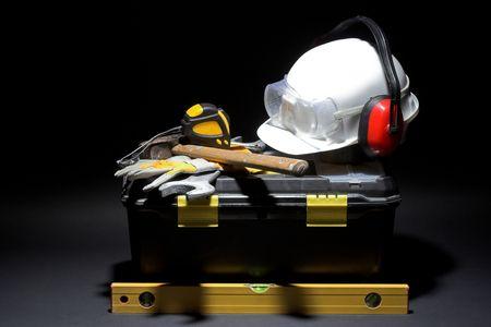 Safety gear kit over dark background  photo