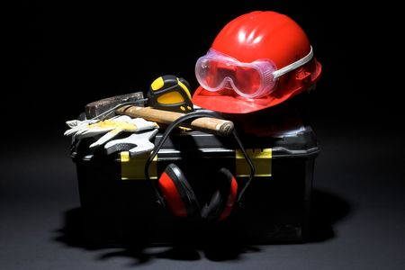 personal safety: Safety gear kit over dark background