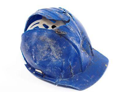 Un casco protettivo blu rotto over white Archivio Fotografico