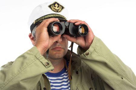 zeeman met een verrekijker over wit Stockfoto
