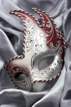 Carnival mask over gray satin Imagens - 7170884