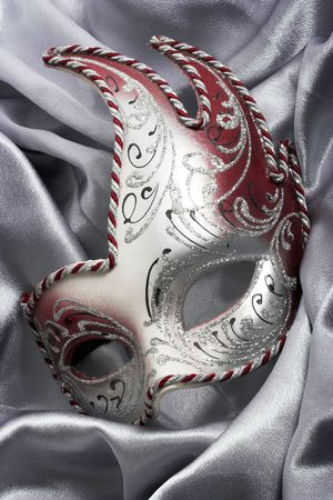 Carnival mask over gray satin