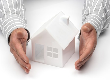 Hands and house model. Real property or insurance concept  Stock Photo - 7248600