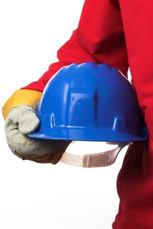 man holding blue helmet over white  Stock Photo