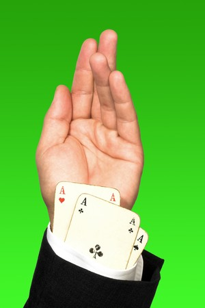 Close up of cheating poker player's hand.Vintage cards Stock Photo - 7331080