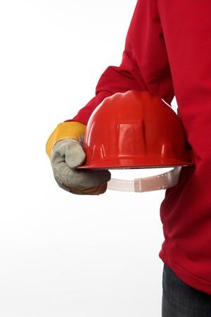 man holding red helmet over white  photo
