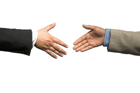 Close up of business handshake over white background
