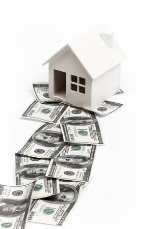 Model of house on the path of money. Real estate concept Stock Photo - 7746394