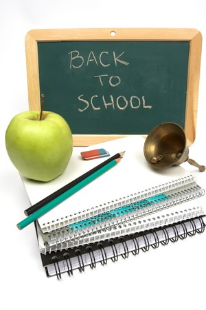 back to school concept- notebooks, apple dnd scool-bell Stock Photo - 7746411