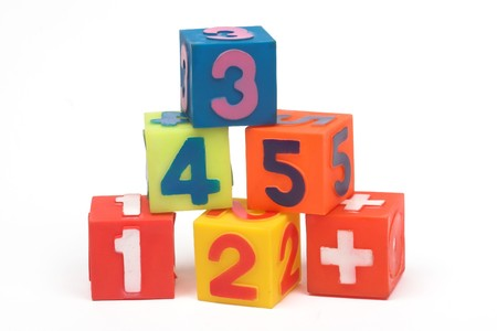 Educational blocks with different numbers over white