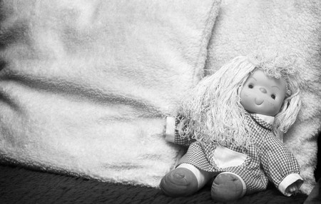 Abandoned rag doll, end of childhood photo
