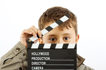 clapper: Boy with movie clapper board over white Stock Photo