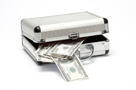 aluminum case with money over white background photo
