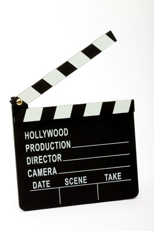 Movie clapper board over white photo