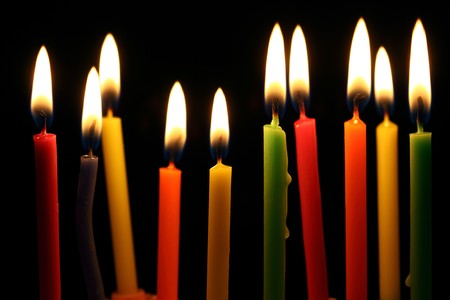 Some lit birthday candles close up  Stock Photo