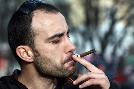 Portrait of a young man smoking sigar Stock Photo - 8260789