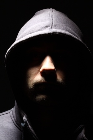Portrait of a young man in a hood  Stock Photo