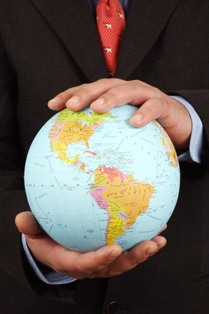 Businessman holding Earth globe in his hands Stock Photo - 8386129