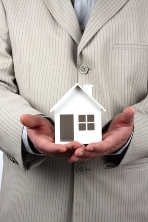 House model in hand. Real property or insurance concept Stock Photo - 8386145