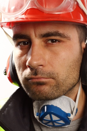 Portrait of a worker with red hard hat photo
