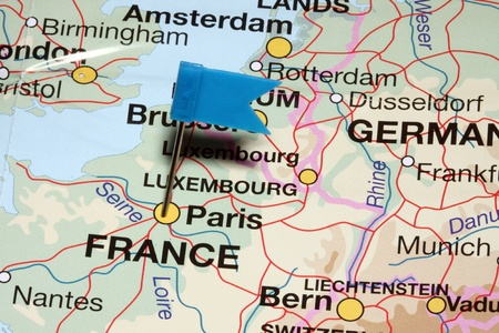 Blue flag pin pointing on Paris in map  photo