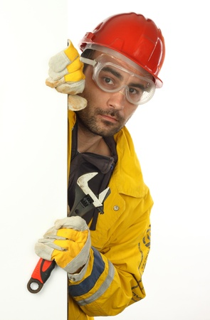 Young worker holding blank poster over white Stock Photo - 8485888