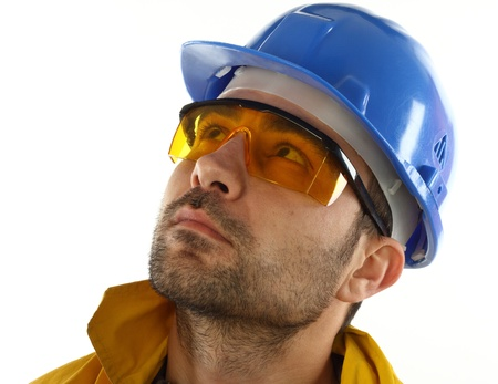 health industry: worker whit blue helmet over white background