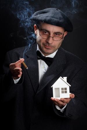 Portrait of retro looking salesman. Real estate concept photo