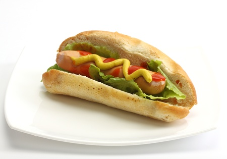 Hot dog with mustard over white background