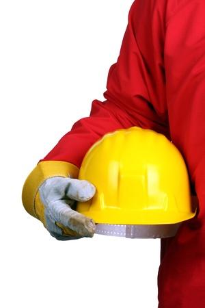 man holding yellow helmet over white background photo