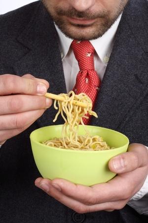 Man holding a bowl of soup  noodles photo