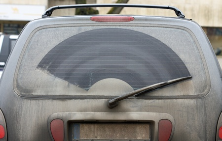 The dirty back window of an automobile  photo