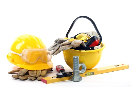 Yellow helmets and industrial tools close up Stock Photo - 8663494