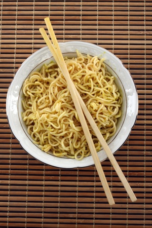 cooked instant noodle: Bowl of instant noodles over white background Stock Photo