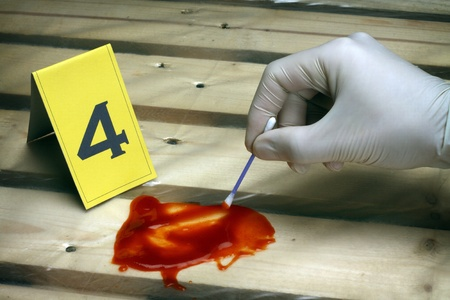 collect evidence. investigator takes a sample Stock Photo