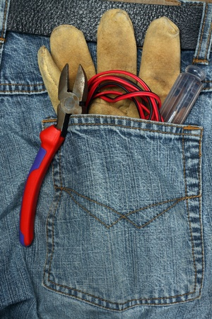 tools in the back pocket of jeans photo